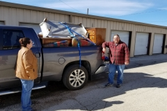 Volunteers load furniture for another New Beginning's family. Providing furnishings for New Beginnings families creates a loving and caring environment and helps make a house a home.